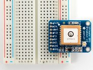 Ultimate GPS Breakout shown on breadboard (not included)
