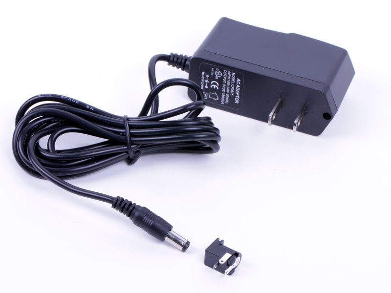 Regulated 9 V DC power supply, shown with jack (sold separately).
