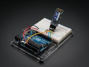 Bluefruit EZ-Link shown on breadboard with Arduino (not included)