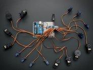 Adafruit 16-Channel 12-bit PWM/Servo Driver - shown with many servo motors