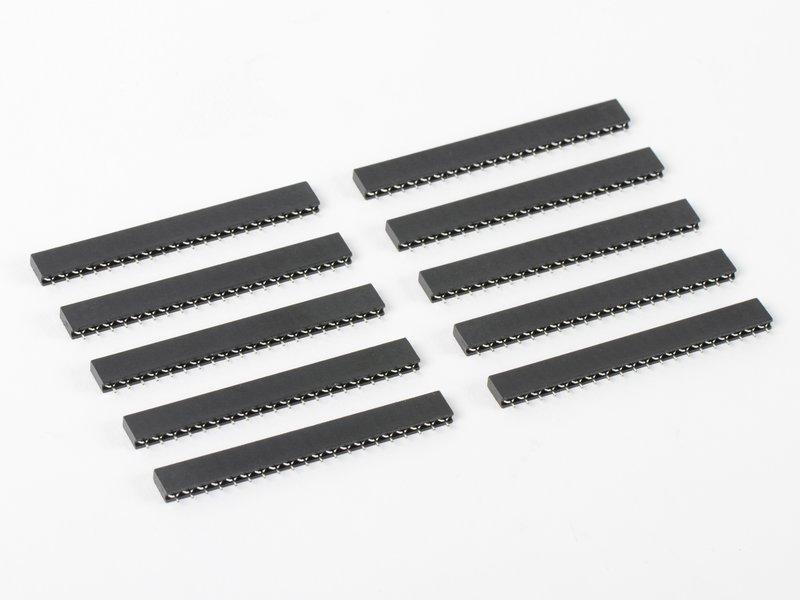 Set of ten 20-pin strips shown in carrier sockets