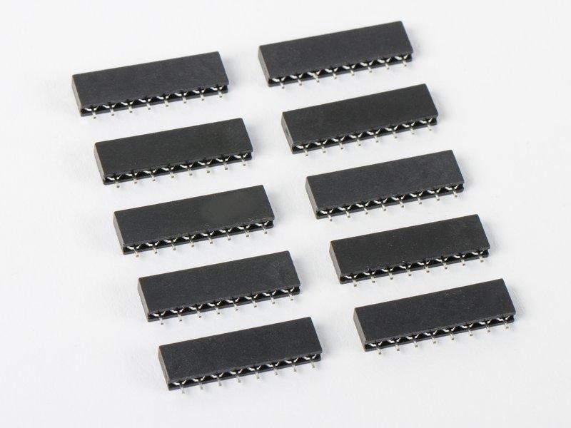 Set of ten 8-pin strips shown in carrier sockets